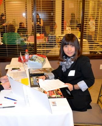 Li Xiong, from China, is our MBA student. Here she is preparing to speaking with a top fashion company at our career fair.